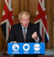 Boris Johnson under presskonferensen. Stefan Rousseau / TT NYHETSBYRÅN