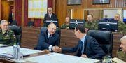 Vladimir Putin och Bashar al-Assad under mötet i Damaskus. SANA / TT NYHETSBYRÅN