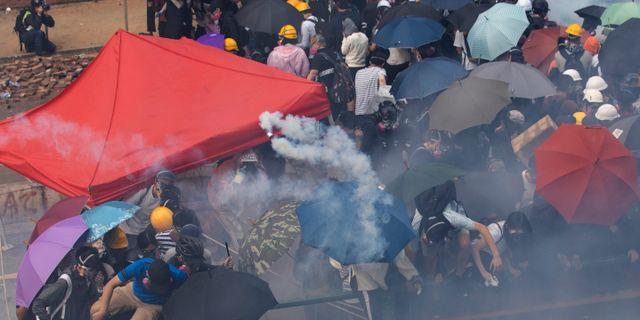 Protester i Hongkong.  Ng Han Guan / TT NYHETSBYRÅN