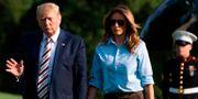 Donald och Melania Trump på väg till Vita huset. ALASTAIR PIKE / AFP