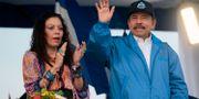 Ortega med hustrun och vicepresidenten Rosario Murillo. INTI OCON / AFP