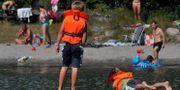 Barn med flytvästar. Arkivbild. Hasse Holmberg / TT / TT NYHETSBYRÅN