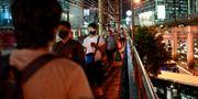 Människor med skyddsmask i Manila ELOISA LOPEZ / TT NYHETSBYRÅN