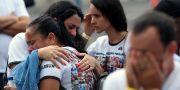 Invånare i Brumadinho i Mina Gerais sörjer sina anhöriga på årsdagen för dammolyckan. Cristiane Mattos / TT NYHETSBYRÅN