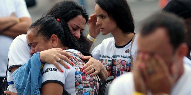Invånare i Brumadinho i Mina Gerais sörjer sina anhöriga på årsdagen för dödsolyckan. Cristiane Mattos / TT NYHETSBYRÅN