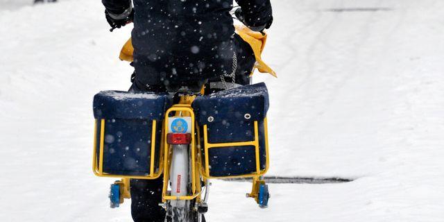 Postudelning i snöyra. Hasse Holmberg / TT / TT NYHETSBYRÅN