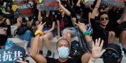 Protester i Hongkong under det kinesiska firandet. SUSANA VERA / TT NYHETSBYRÅN