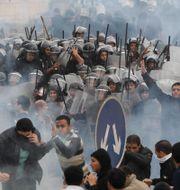 Sammandrabbningar mellan polis och demonstranter i Kairo i januari 2011 Ben Curtis / TT NYHETSBYRÅN