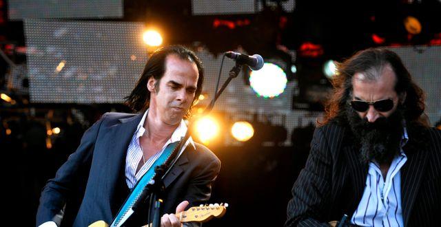 Nick Cave och Warren Ellis på Roskildefestivalen 2009/Arkivbild PONTUS LUNDAHL / TT / / TT NYHETSBYRÅN