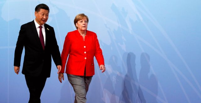 Xi Jinping och Angela Merkel.  Wolfgang Rattay / TT NYHETSBYRÅN