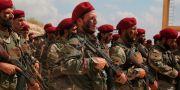 Styrkor med turkiskt stöd från Fria syriska armén på en militärträning idag. STR / TT NYHETSBYRÅN