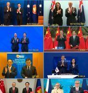 Deltagarna i det virtuella toppmötet i Vietnam, där RCEP-avtalet undertecknades.  AP/Vietnam News Agency
