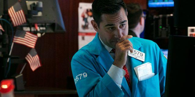 Investerare på börsgolvet i New York. Richard Drew / TT NYHETSBYRÅN