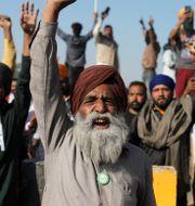 Bild från protesterna.  Altaf Qadri / TT NYHETSBYRÅN