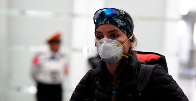 En kvinna med munskydd. ALFREDO ESTRELLA / TT NYHETSBYRÅN