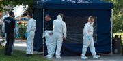 Polisen arbetar vid mordplatsen.  PAUL ZINKEN / dpa