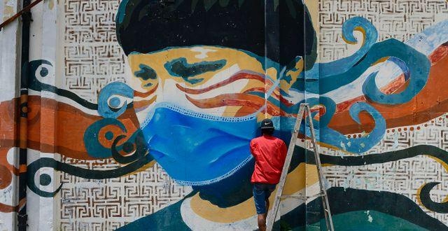 Graffitimålning i Caracas, Venezuela Matias Delacroix / TT NYHETSBYRÅN