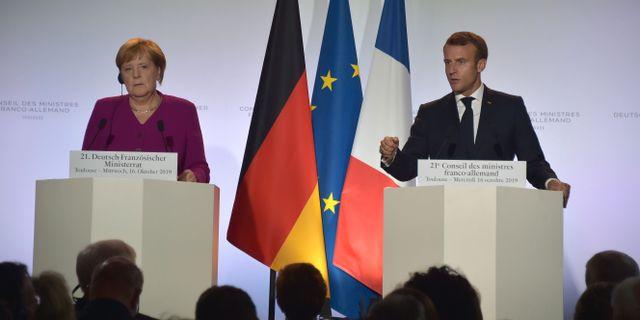 Merkel och Macron under onsdagens presskonferens. PASCAL PAVANI / AFP