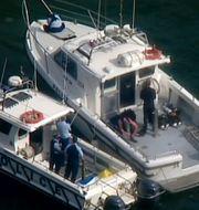 Räddnings- och sökpersonal på Hawkesbury River  efter flygolyckan som kostade Cousins liv.  TT / NTB Scanpix