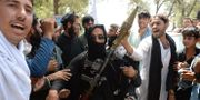 En taliban firar id al-fitr med bybor under vapenvilan i Afghanistan NOORULLAH SHIRZADA / AFP