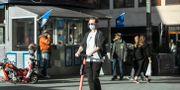 Person med munskydd.  Anders Wiklund/TT / TT NYHETSBYRÅN