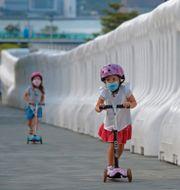 Tedros Adhanom Ghebreyesus/Barn med munskydd i Hongkong TT