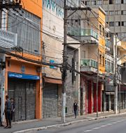 Stängda affärer under coronapandemin i Brasilien. Andre Penner / TT NYHETSBYRÅN