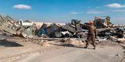 Basen fick omfattande skador. Ali Abdul Hassan) / TT NYHETSBYRÅN