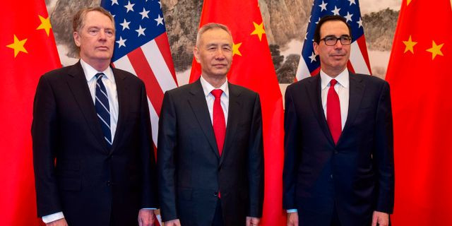 Robert Lighthizer, Liu He, Steven Mnuchin. NICOLAS ASFOURI / AFP