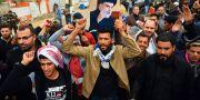 Demonstranter i Irak. HAIDAR HAMDANI / TT NYHETSBYR�N