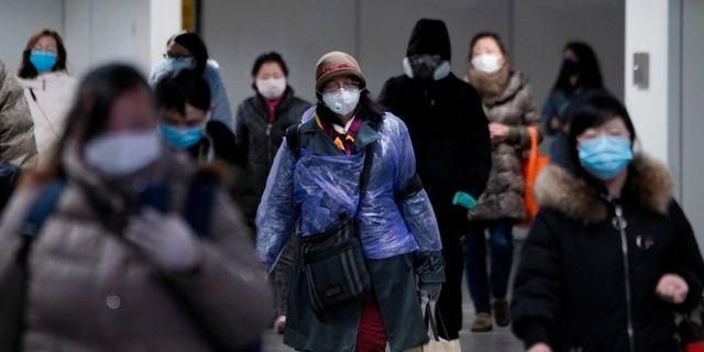 Illustrationsbild: Människor med masker i Shanghai.  ALY SONG / TT NYHETSBYRÅN