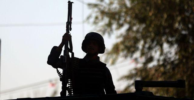 Polis i Afghanistan. Massoud Hossaini / TT NYHETSBYRÅN/ NTB Scanpix