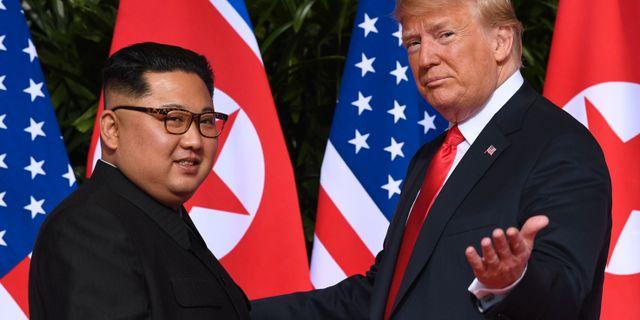 Kim Jong-Un och Donald Trump vid sitt möte tidigare i år. SAUL LOEB / AFP