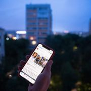 A user holds a smartphone with an opened Facebook page in Moscow, Russia, Thursday, June 10, 2021. Russian authorities have ordered Facebook and messaging app Telegram to pay steep fines for failing to remove banned content. The move could be part of growing Russian efforts to tighten control over social media platforms. Pavel Golovkin / TT NYHETSBYRÅN