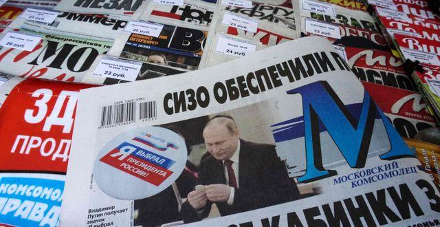 Putin i tidningarna.  KIRILL KUDRYAVTSEV / AFP