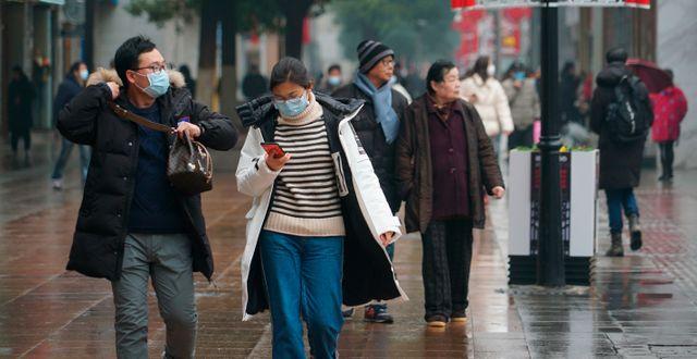 Invånare i Wuhan  Dake Kang / TT NYHETSBYRÅN