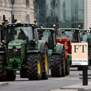 Farmers from the group Save British Farming drive tractors across Westminster Bridge, in London, in a protest against cheaply produced lower standard food being imported from the U.S. after Brexit that will undercut them, Wednesday, July 8, 2020. TT