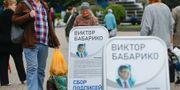 Valaffischer för Viktor Babaryk i Minsk. Sergei Grits / TT NYHETSBYRÅN