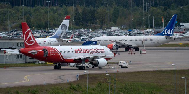 Flygplan från Atlasjet (Atlas Global), Norwegian och SAS parkerade vid privatjetplattan på Arlanda. Johan Nilsson/TT / TT NYHETSBYRÅN