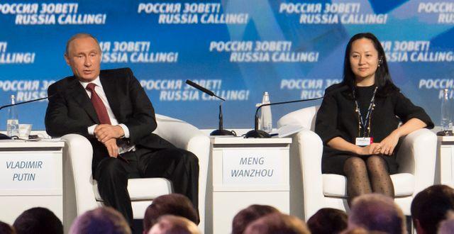 Wanzhou Meng intill Putin STRINGER / TT NYHETSBYRÅN