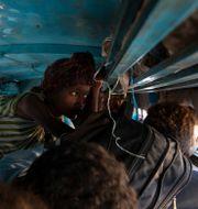 Flyktingar från Tigrayregionen ombord på buss. Arkivbild. Nariman El-Mofty / TT NYHETSBYRÅN