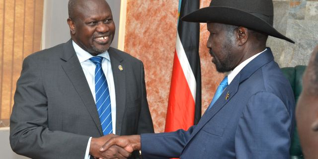 Riek Machar och Salva Kiir. AKUOT CHOL / AFP