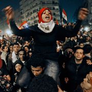 An Egyptian woman celebrates with other people after President Hosni Mubarak resigned and handed power to the military at Tahrir square, in Cairo, Egypt, Friday, Feb. 11, 2011. Hussein Malla / TT NYHETSBYRÅN