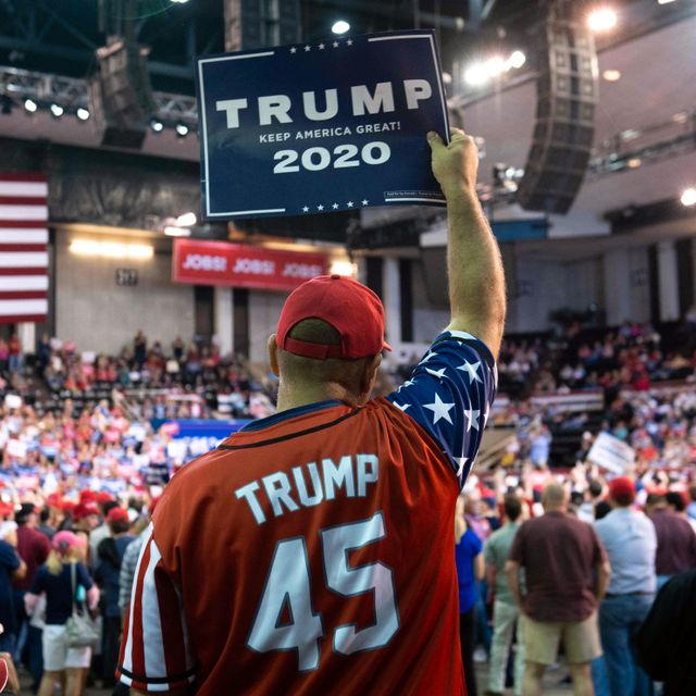 "A supporter holds up a sign as the US president speaks during a ""Keep America Great"" rally at Sudduth Coliseum at the Lake Charles Civic Center in Lake Charles, Louisiana. SAUL LOEB / AFP"