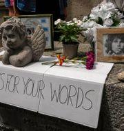 Jim Morrisons grav i Paris är välbesökt av hans fans. Michel Euler / TT NYHETSBYRÅN