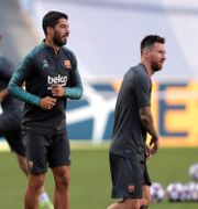 Luis Suárez  och Lionel Messi. POOL / BILDBYRÅN