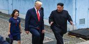 Donald Trump och Kim Jong-Un under mötet i somras. Arkivbild. TT