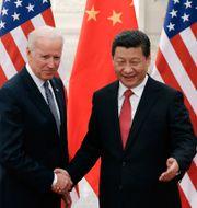 Biden och Xi under ett möte 2013. Lintao Zhang / TT NYHETSBYRÅN