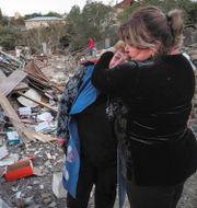 Kvinnor sörjer efter förödelsen i Armenien. TT NYHETSBYRÅN