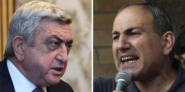 Premiärminister Serzj Sargsian och oppositionsledaren Nikol Pashinyan.  KAREN MINASYAN / AFP